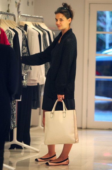 Former Dawson's Creek star, Katie Holmes, is seen shopping at Stella  McCartney in West Hollywood, CA. She pairs a black dress with a white bag,  ...