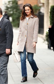 Katie Holmes was spotted outside her New York City hotel wearing blue jeans and a patterned coat.