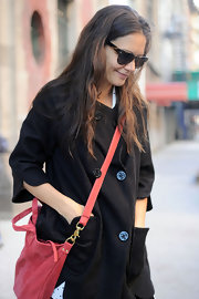 Katie Holmes wore her long hair loose and with a slight natural wave while heading to a dance studio.
