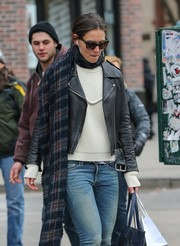 Katie Holmes teamed a plaid scarf with a leather jacket and a sweater for a cold day out in New York City.