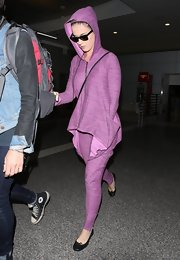 Katy Perry wasn't afraid of playing matchy-matchy when she flew into LAX wearing this purple hoodie and matching pants.