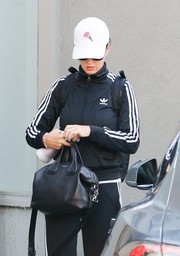 Katy Perry kept a low profile with a white baseball cap while out in West Hollywood.