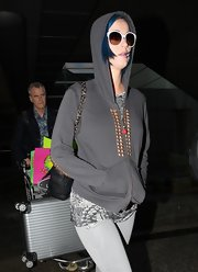 Katy Perry covered up her new blue 'do with a studded charcoal hoodie.