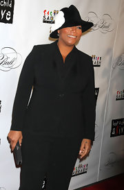 Queen Latifah wore a black single button blazer over a silky cowl neck top at the Black Ball.