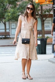Keira Knightley paired her cute dress with strappy thong sandals by Sergio Rossi.