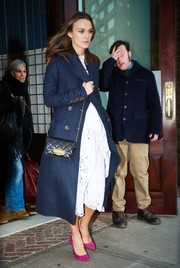 Keira Knightley made her way to 'Jimmy Fallon' wearing a navy Burberry Prorsum wool coat over a delicate white dress.