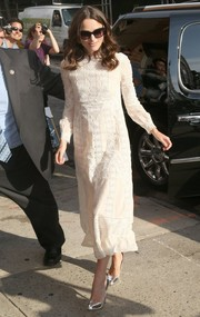 Keira Knightley kept it modest yet elegant in a long-sleeve white eyelet dress by Valentino during her appearance on 'The Daily Show with Jon Stewart.'