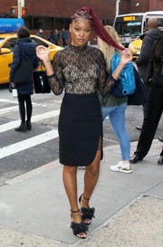For her footwear, Keke Palmer went the frothy route with a pair of tulle bow sandals by Isa Tapia.