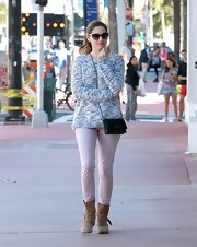 Kelly teamed her pastel pants up with a heathered, chunky knit sweater.