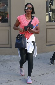 Kelly Rowland rounded out her look with pastel-hued Nikes.