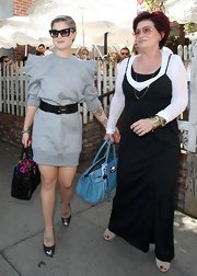 Sharon Osbourne dined out with her daughter Kelly and was carrying a blue leather tote.