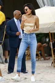 Kendall Jenner flaunted her figure in a skimpy cami by Are You Am I while partying at the beach.