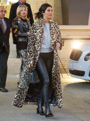 Kendall Jenner cut an imposing figure in a leopard-print fur coat by Plein Sud while shopping in Beverly Hills.