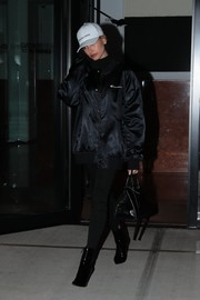 Hailey Baldwin stepped out on a cold NYC night wearing an oversized black bomber jacket by Supreme x Champion.