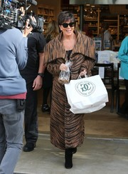 Kris Jenner looked fierce in a tiger-print fur coat while filming scenes for her reality show.