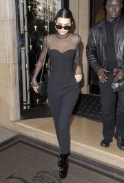 Kendall Jenner highlighted her tiny waist in a black mesh-panel corset top while out in Paris.