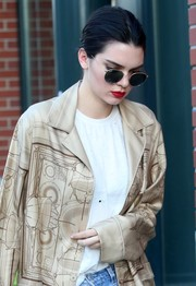 Kendall Jenner looked a little somber as she went out and about in New York City with her Ray-Bans on.