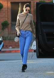 Kendall Jenner chose a pair of classic jeans by Re/Done to team with her sweater.