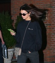 Kendall Jenner finished off her look with a pair of oval sunglasses by Elizabeth and James.