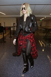 Khloe Kardashian flew out of LAX wearing an edgy black bomber and leggings combo.
