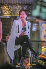 Kris Jenner sealed off her look with chic black patent boots.