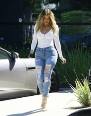 Khloe Kardashian flaunted her curves in a sultry white bodysuit by Naked Wardrobe while out in Calabasas.