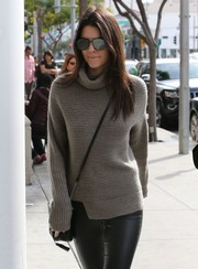 Kendall Jenner was sporty-chic in her mirrored aviators while shopping in Beverly Hills.