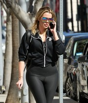 Khloe Kardashian shielded her eyes with chic iridescent aviators while out and about in Beverly Hills.