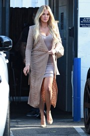 Khloe Kardashian stepped out of a Van Nuys studio looking chic in a beige Balmain duster coat layered over a body-con mini dress.