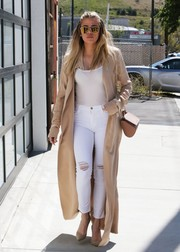 Khloe Kardashian was head turner on the streets of Van Nuys in an ankle-length beige silk trenchcoat by August Getty Atelier.
