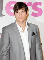 Ashton Kutcher showed off his black pocket scarf.