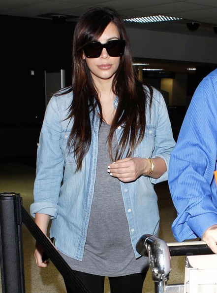 Kim Kardashian in a chambray shirt.