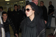 Dressed all in black, Kim Kardashian is pictured at Los Angeles International Airport (LAX)