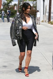 Kim Kardashian topped off her ensemble with a mega-studded leather jacket by Enfants Riches Déprimés.