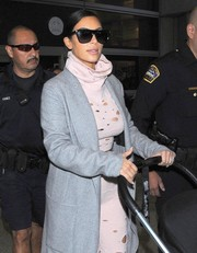 A pair of sporty Saint Laurent shades made sure Kim Kardashian was protected from all those paparazzi flashbulbs as she arrived at LAX.