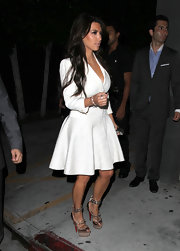 Kim Kardashian stepped out for dinner at Nobu wearing metallic platform peep toe pumps embellished with silver spikes and straps.