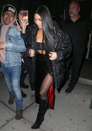 The reality star teamed her jacket with a high-slit velvet skirt and a bandeau top (so very Kim!).