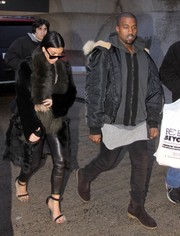 Kim Kardashian was in a 'furry' mood, teaming her coat with a pair of rabbit fur-lined sandals by Celine.