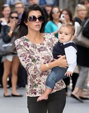 Kourtney dressed Mason up in a cute little sweater vest with jeans.