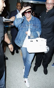 Kris Jenner was spotted at LAX dressed down in a blue denim jacket.