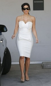 Kim Kardashian went shopping in West Hollywood wearing her bridal shower dress, a white pearl-strap halter dress that hugged her curves beautifully.