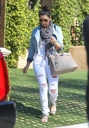 Kim Kardashian looked casual cool in these white ripped jeans and denim jacket.