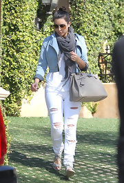 Kim Kardashian wore this muted gray gauzy scarf while out in So Cal.