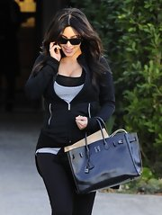 Kim paired her workout clothes with an Hermes bag.