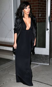Kim Kardashian donned yet another asset-revealing gown for a night out in New York City.