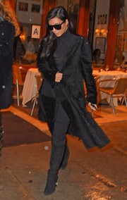 Kim Kardashian battled the New York chill in luxurious style with a black Calvin Klein fur coat.
