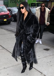 Kim Kardashian looked characteristically posh in a black fur coat by Rochas while out and about in New York City.