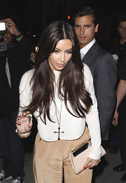 Kim Kardashian styled her outfit with a Low Luv x Erin Wasson cross pendant necklace.