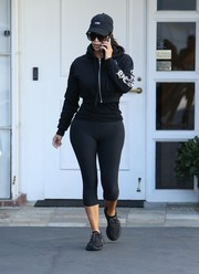 Kim Kardashian pulled her sporty look together with a pair of black Adidas x Kanye West Yeezy 350 Boost sneakers.
