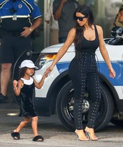 Kim Kardashian turned heads in Bal Harbour wearing this low-cut black bodysuit by LPA.